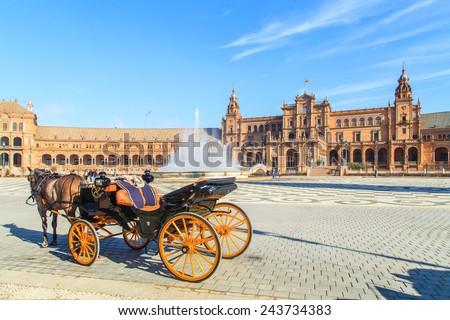 Horses and carts on Plaza de Espana in Seville, Spain - stock photo