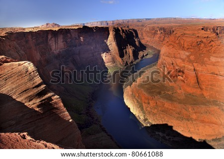 Horseshoe Bend Orange Glen Canyon Overlook Blue Colorado River Entrenched Meander Page Arizona - stock photo