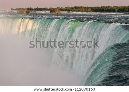 Horseshoe Falls as viewed from Table Rock in Queen Victoria Park at twilight in Niagara Falls, Ontario, Canada - stock photo