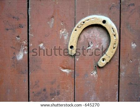 Horseshoe on wall - stock photo