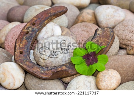 horseshoe with four leaf clover on stones, Thank you - stock photo