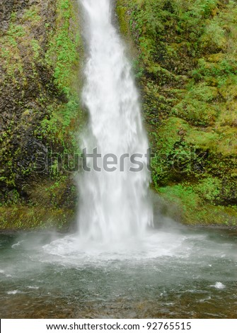 Horsetail Falls and rocky pool of water - stock photo