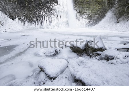 Horsetail Falls at Columbia River Gorge in Oregon Frozen in Winter Season - stock photo