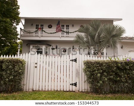 Hose decorated for Christmas on Stock Island, Florida. - stock photo