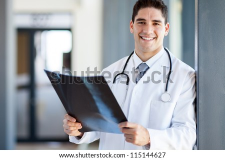 hospital doctor holding patient's x-ray film - stock photo