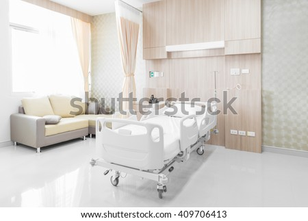 Hospital room with beds and comfortable medical equipped - stock photo