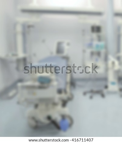 Hospital room with beds and comfortable medical equipped in a modern hospital-blurred - stock photo