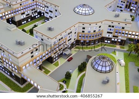 Hospital scale model, layout of medical building, miniature of big city healthcare centre with infrastructure, ambulance service, modern architecture and design, selective focus  - stock photo
