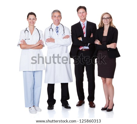 Hospital staff represented by both the medical profession in the form of a doctor and the business administrators - stock photo