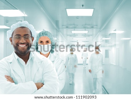 Hospital team in modern facility - stock photo