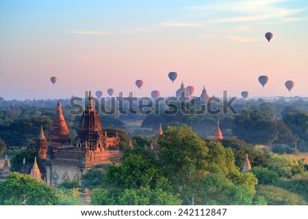 Hot air ballons over pagodas in sunrise at Bagan, Myanmar. - stock photo