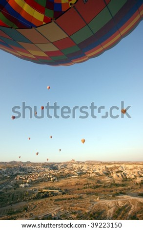 Hot air balloon above the landscape - stock photo