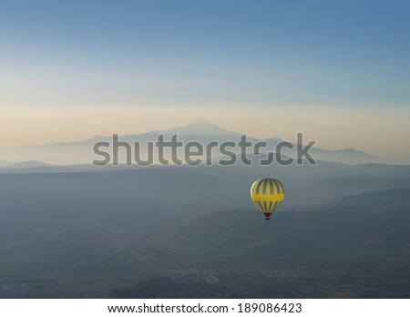 Hot air balloon and Erciyes volcano mountain, Kapadokya, Turkey - stock photo
