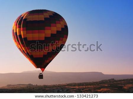 Hot Air Balloon at sunrise - stock photo