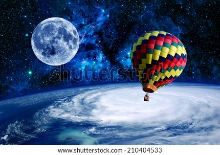 Hot air balloon Earth moon space stars adventure. Elements of this image furnished by NASA. - stock photo