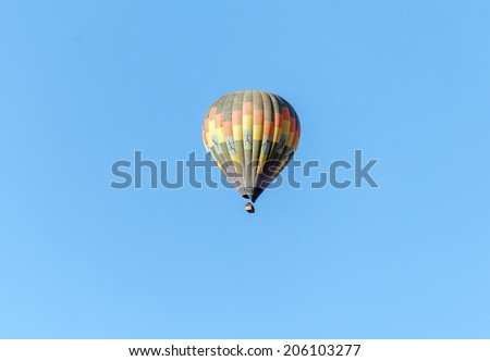 Hot air balloon flies over the Sossusvlei plato of Namib Naukluft National Park - Namibia, South Africa - stock photo
