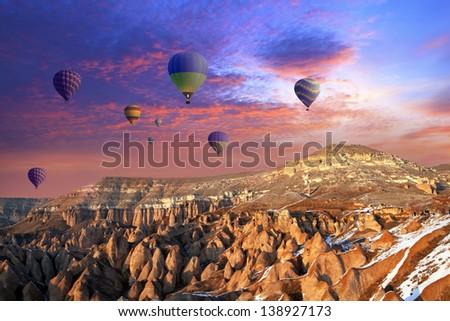 Hot air balloon flying over  Cappadocia - stock photo