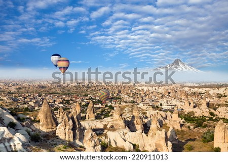 Hot air balloon flying over Cappadocia, next to erciyes mountain  - stock photo