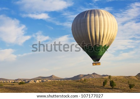 Hot air balloon flying over Cappadocia, Turkey - stock photo
