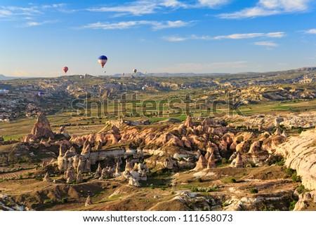 Hot air balloon flying over Cappadocia, Turkey - stock photo