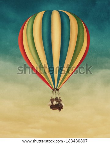 Hot air balloon high in the sky - stock photo