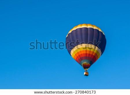 hot air balloon in blue sky - stock photo