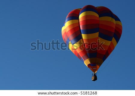 Hot air balloon in early morning light - stock photo