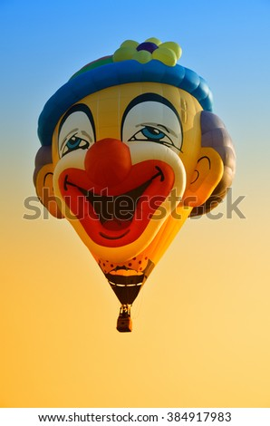 Hot air balloon in flight in the sky in a nice day - stock photo