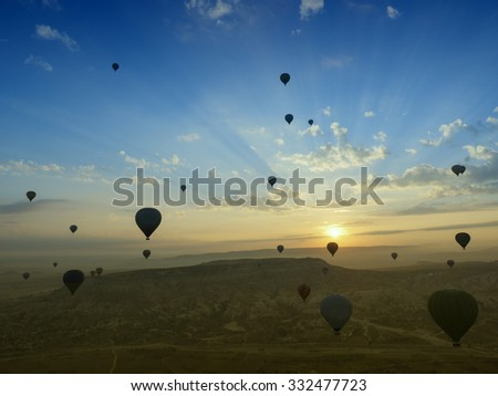 Hot air balloon is flying at beautiful sunset - stock photo