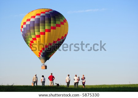 hot air balloon landing - stock photo