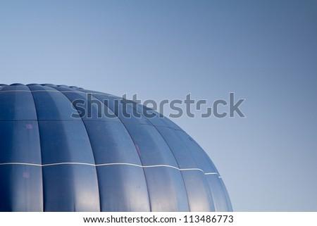 hot air balloon over blue sky - stock photo