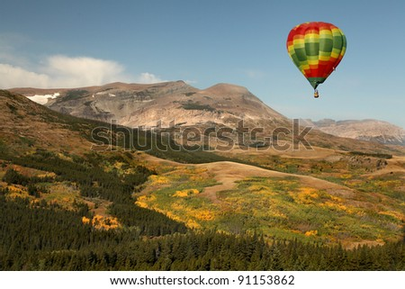 Hot Air Balloon Over Montana Mountainous Terrain - stock photo