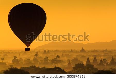 Hot air balloon over plain of Bagan at sunrise, Myanmar - stock photo