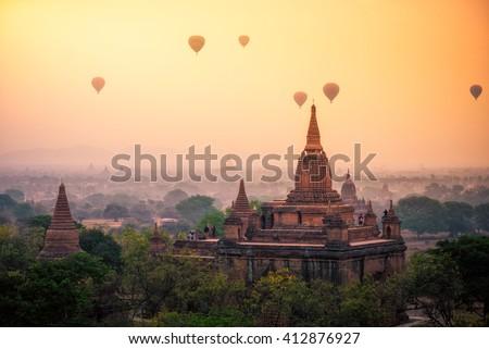 Hot air balloon over plain of Bagan in misty morning, mandalay Myanmar  - stock photo