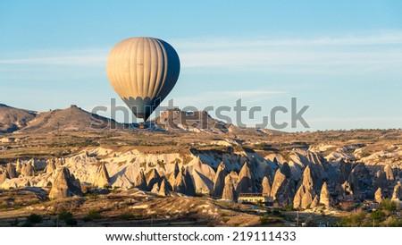 Hot air balloon rising on Cappadocia, Turkey - stock photo