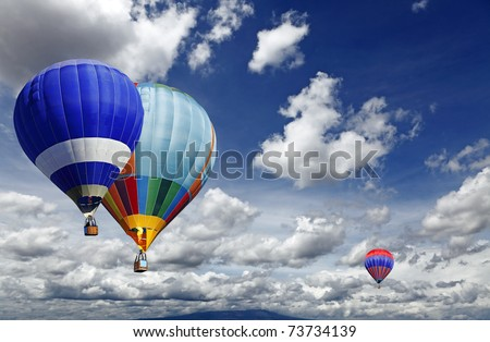 Hot air balloon sporting activity on a fresh blue day. - stock photo