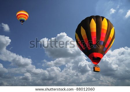 hot air balloon with beautiful blue sky and nice cloud in Thailand. - stock photo