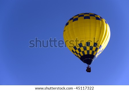 Hot air balloon with sky as copy space - stock photo