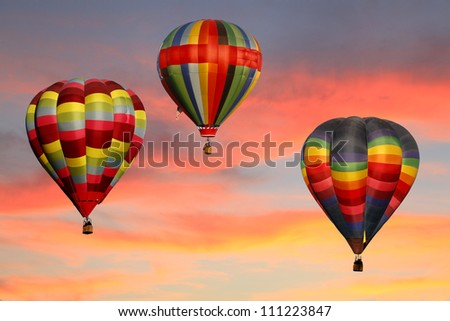 Hot Air Balloons Ascending at Sunrise - stock photo