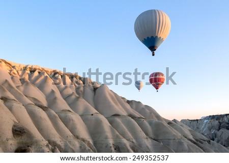 Hot air balloons fly over Cappadocia. - stock photo