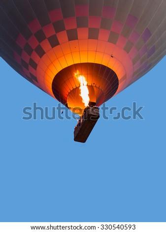 Hot air balloons fly over Cappadocia - stock photo