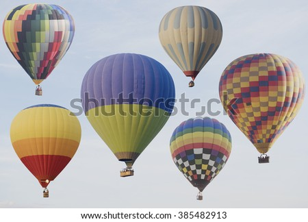 Hot air balloons flying with blue sky - stock photo