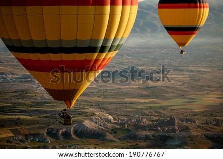 Hot Air Balloons Over Cappadocia, Turkey - stock photo