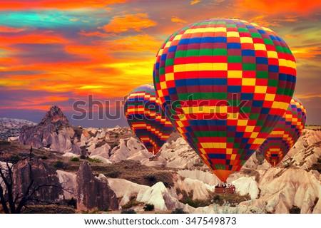 Hot air balloons sky mountain Cappadocia Goreme National Park Turkey. - stock photo