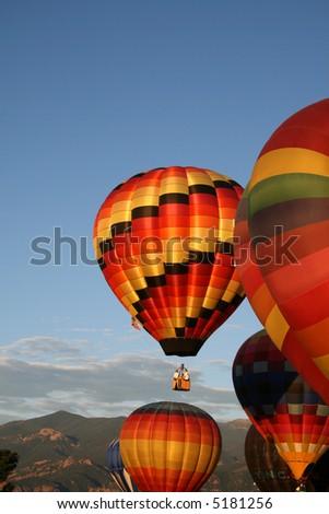 Hot air baloons in morning sun - stock photo