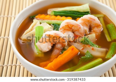hot and sour soup with shrimp and vegetables, Thai Food - stock photo