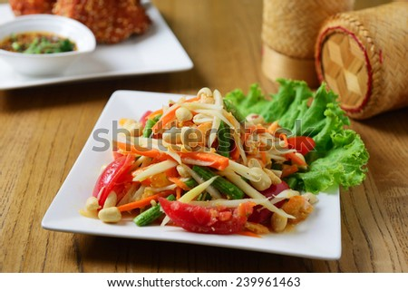 Hot and spicy papaya salad, Thai cuisine - stock photo