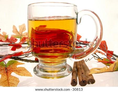 Hot apple Cider and cinnamon sticks. - stock photo