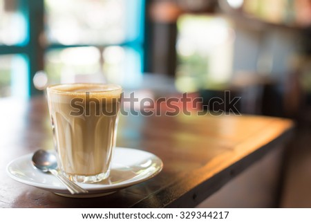 Hot art Latte Coffee in a cup on table. - stock photo