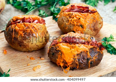 Hot Baked Potato with cheese, bacon and sour cream.  - stock photo